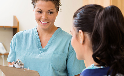 female medical assistant talking to a patient
